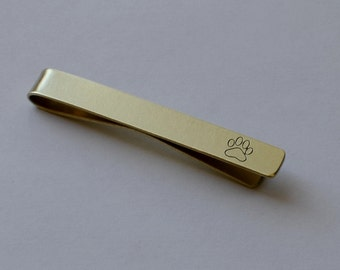 tie bar with a paw print in 14K solid gold