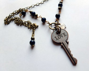 love stamped key with blue marcasite and pyrite on long antiqued brass chain, unique, ooak