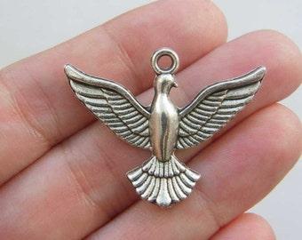 4 Dove charms antique silver tone B53