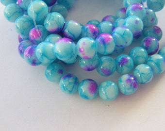 105 Blue and pink glass beads B171