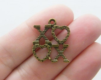 6 XOXO charms antique bronze tone BC6