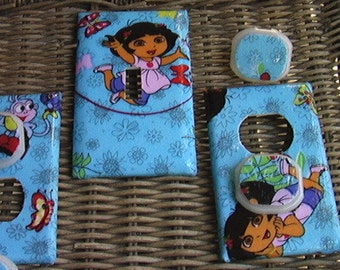 Dora Set on Purple Light Switch Toggle Cover Plate and 2 Outlets Set includes child safety plugs