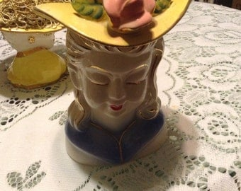 Lady head vase with yellow hat