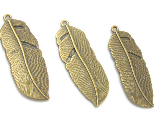 4 Large Brass tone feather charms 43 mm x 15 mm  - CM092