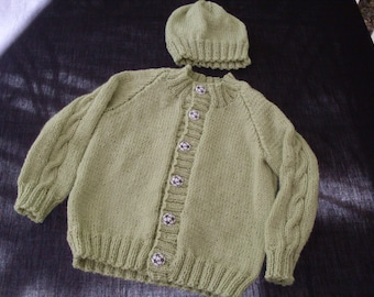 Hand knit boy or girl light green cardigan and hat
