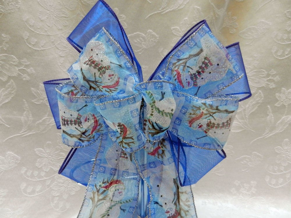 Christmas/ winter bow snowman ribbon on a sheer royal blue ribbon