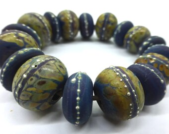 17 Handmade Glass Beads in Beautiful Opaque Matte Purples and Blues with Multi Colored Frit and Fine Silver by SRA Sarah Klopping