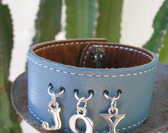 "SALE!!!! Light Blue Leather Cuff With Sterling Silver ""JOY"" Message"
