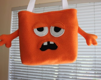 Sleepy orange monster bag