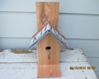 Bird house with license plate roof