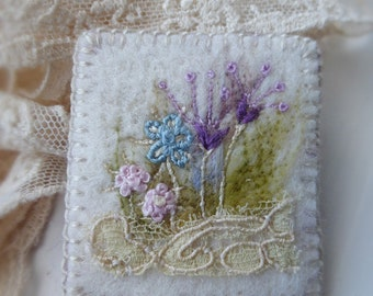 Embroidered Flowerbed Felt Brooch with Antique Lace