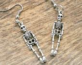 The SKELETON Earrings...silver. antique silver charm. skeleton earrings. hand. retro. kitsch. boho. metal. urban. hipster. hippie. creepy