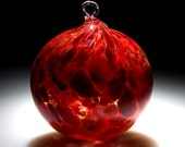 """Glass Ornament.  Sun catcher.  Hand Blown Art Glass in """"Garnet Red"""".  Made in Seattle.  Artist Dehanna Jones."""