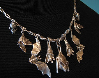 Magnificent 7 Bat Necklace with Skulls in Sterling Silver