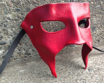 RENEK Leather wearable art mask designed to be worn with a brim hat or ball cap.