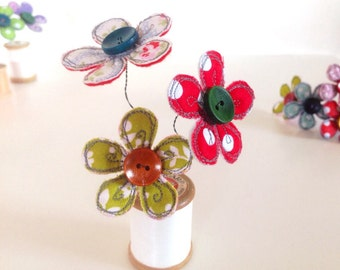 Cheerful little embroidered fabric flower and vintage cotton spool decoration
