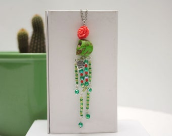 Green Frida Kahlo inspired necklace with sugar skull and rose pendent