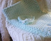 BLANKET. light green with matching hat in a beautiful solf quality acrylic yarn