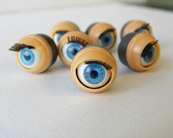 Blinking doll eyes