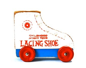 Vintage Wooden Lacing Shoe on Wheels
