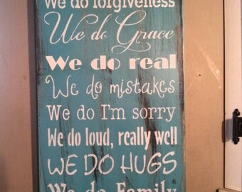 In this house we do Grace we do real we do hugs we do loud really well we do real  sign we do real primitive wood sign hand painted