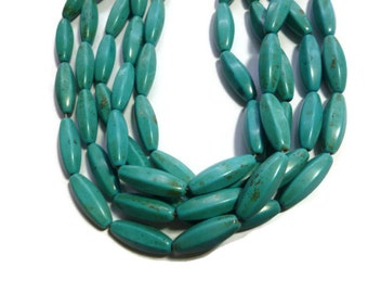 Teal Magnesite - 6-sided Rice - 25mm x 9mm - Full Strand - 15 beads