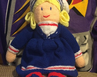 This doll is hand knitted and a doll any little girl will love