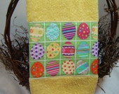 Easter decor hand/dish towel, colorfully decorated eggs on green fabric, daffodil yellow towel, 100% cotton terry, spring colors, sparkly