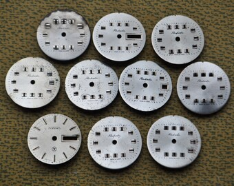 Set of 10 vintage wrist watch faces.