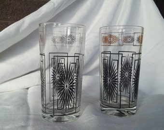 Two (2) Vintage glasses. Pretty starburst black and gold retro designs.