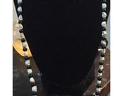 Black and White Skull Necklace with heart clasp