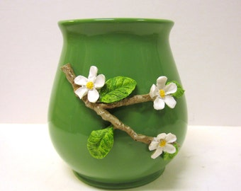 Green Pottery Vase with attached Branch of Flowers