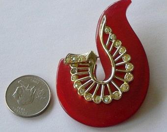 red and rhinestone brooch