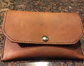 Rustic Brown Leather Lined Pipe Tobacco Pouch Lined With Black Pigskin and Closes with a Black Nickel Snap.