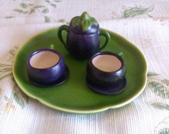Eggplant Cup and Saucer with Pot and Lid on Green Plate