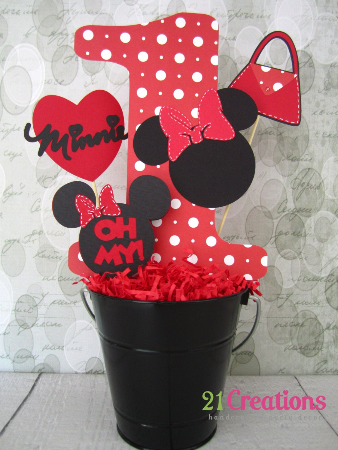 Minnie mouse centerpiece inserts in red bucket by