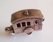 Silver Nuvo Caravan and Furniture Opening Charm