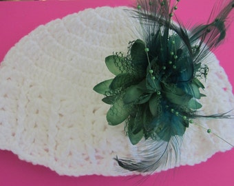 White adult crochet hat with dramatic detachable green flower