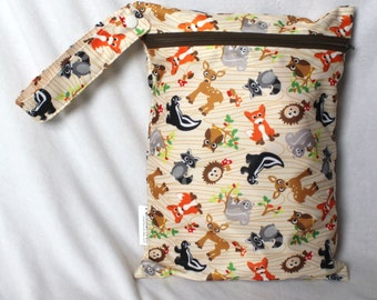 "Wet bag in super cute animal forest friends print! 9""x12"" perfect travel size! fits approximatley 4 cloth diapers"