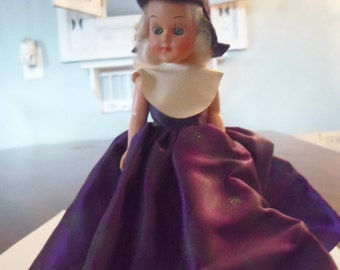 Plastic Celluloid Doll Sleepy Eye Blonde Doll in Purple Gown