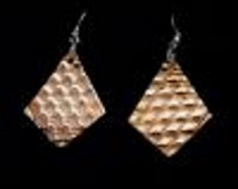 Corrigated copper earrings withsterling silver earwires.