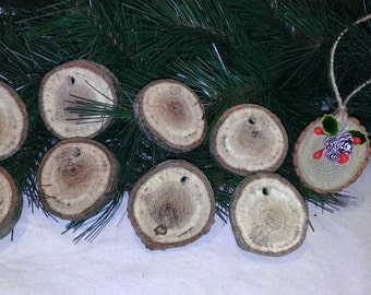 Wood rounds with drilled holes for making ornaments.