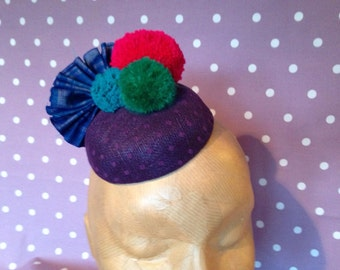 Handmade circus pom pom headpiece/fascinator, polkadot sinamay base, ikat fabric fan