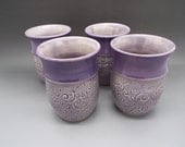Wheel thrown 10 oz pottery tumblers in translucent purple glaze with stamped swirls, stoneware pottery