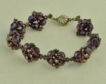 Amethyst and bronze Czech fire polished glass beads bracelet.
