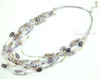 Amethyst,freshwater pearl on silk necklace.