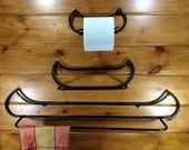 Canoe shapsd wall mounted towel holder. Approximatly 31 inchs