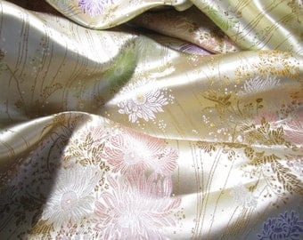 Chinese brocade fabric in pale gold - ONE yard of pale gold satin brocade fabric with a floral design in lilac, pink, gold and bronze