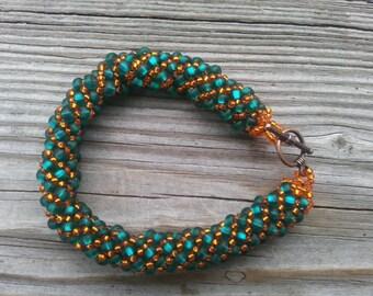 Coastline At Sunset Orange and Teal Russian Spiral Bracelet