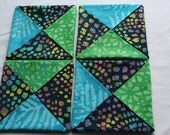 Folded Fabric Coasters ; Mug Rugs ; Candle Mats ; Home Décor ; Quilted Coasters ; Batik Fabrics ; Home Decor ; Little Quilts ; Kitchen Decor